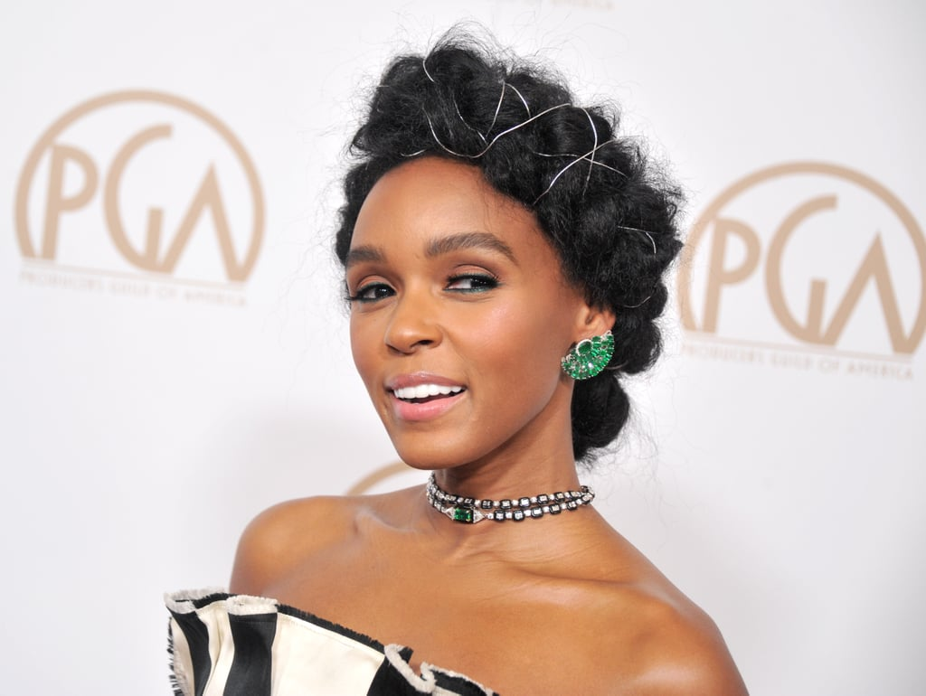Earlier this month Janelle Monaé revealed that her quirky hair accessories, which included gold wire, safety pins, and googly eyes, are a part of hidden messages she is sending through her hair. The CoverGirl delivered yet another message while rocking a braided crown with silver wire woven in between on the red carpet of the 2017 Producers Guild Awards.  Janelle paired her regal hairstyle with a nude pink lip and emerald green eyeliner to match her bedazzled earrings. Keep scrolling for a close-up look and let us know if you can spot what hidden messages Janelle has been sending us thus far.