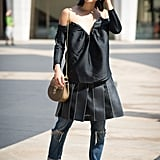 Just because you're wearing an LBD doesn't mean you can't also wear your favorite pair of distressed jeans. Layer up to add a fun effect to a more oversize dress set.