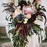 King protea, heather, dahlia, amaranth, and sea holly