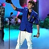 Justin Bieber raised his golden popcorn on stage in 2011.