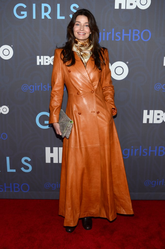 Paulina Porizkova wore a long orange coat.