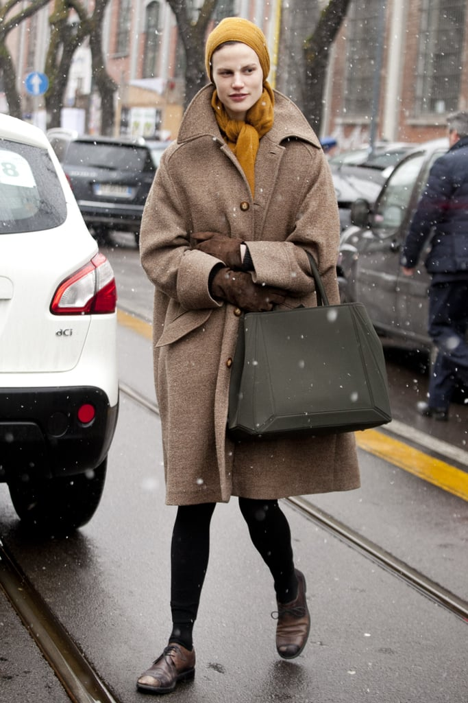 An oversize coat in a classic camel hue was the star of this showgoer's look.