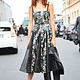 Taylor Tomas Hill was the picture of retro-cool in a full-skirted floral dress, but don't be fooled. She also included a tougher black leather jacket to make it interesting. Source: Greg Kessler