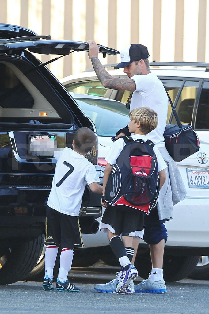 David Beckham, Cruz Beckham, and Romeo Beckham get their soccer gear.