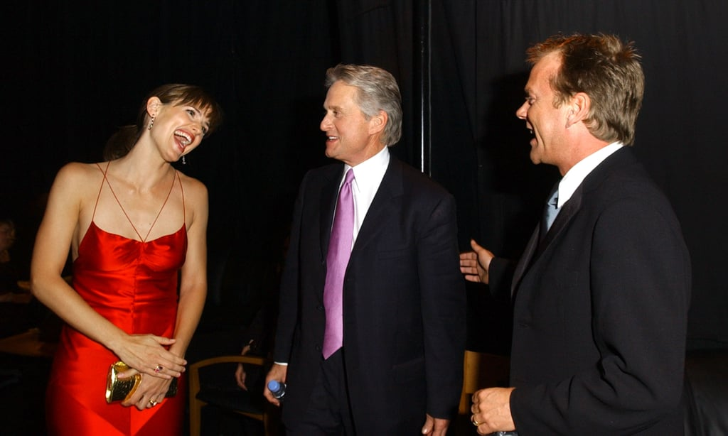 Jennifer Garner, Michael Douglas, and Kiefer Sutherland shared a moment backstage in 2004.