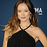 Looking more stunning than ever, Olivia Wilde showed off her long ombré strands and topped off her black dress with a hot pink lipstick.