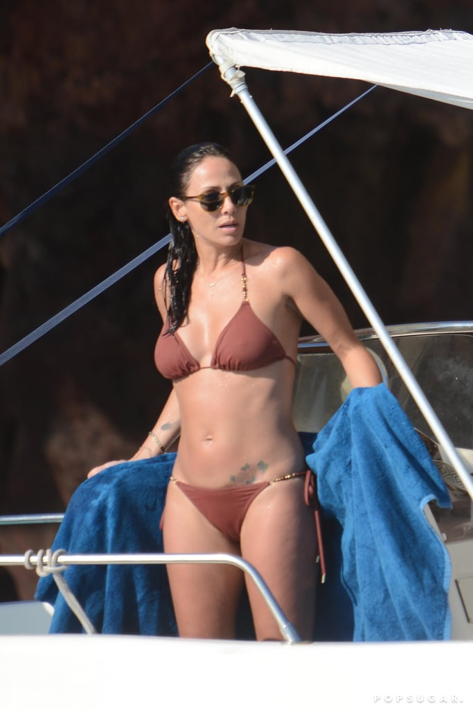 """Natalie Imbruglia spent the day on a boat during her vacation in Lipari, Sicily, on Sunday. The Australian singer-songwriter, who shot to fame in the US with her hit """"Torn"""" in 1997, looked amazing in a brown string bikini as she took a dip in the water and toweled off on board with a group of friends. Natalie has been living in London for the past two decades, but the 41-year-old recently spent a reported $1.3 million on a home in Australia's Byron Bay after admitting to being a bit homesick. Apparently her new neighbors include Simon Baker and Chris Hemsworth, which is certainly worth the hefty price tag."""