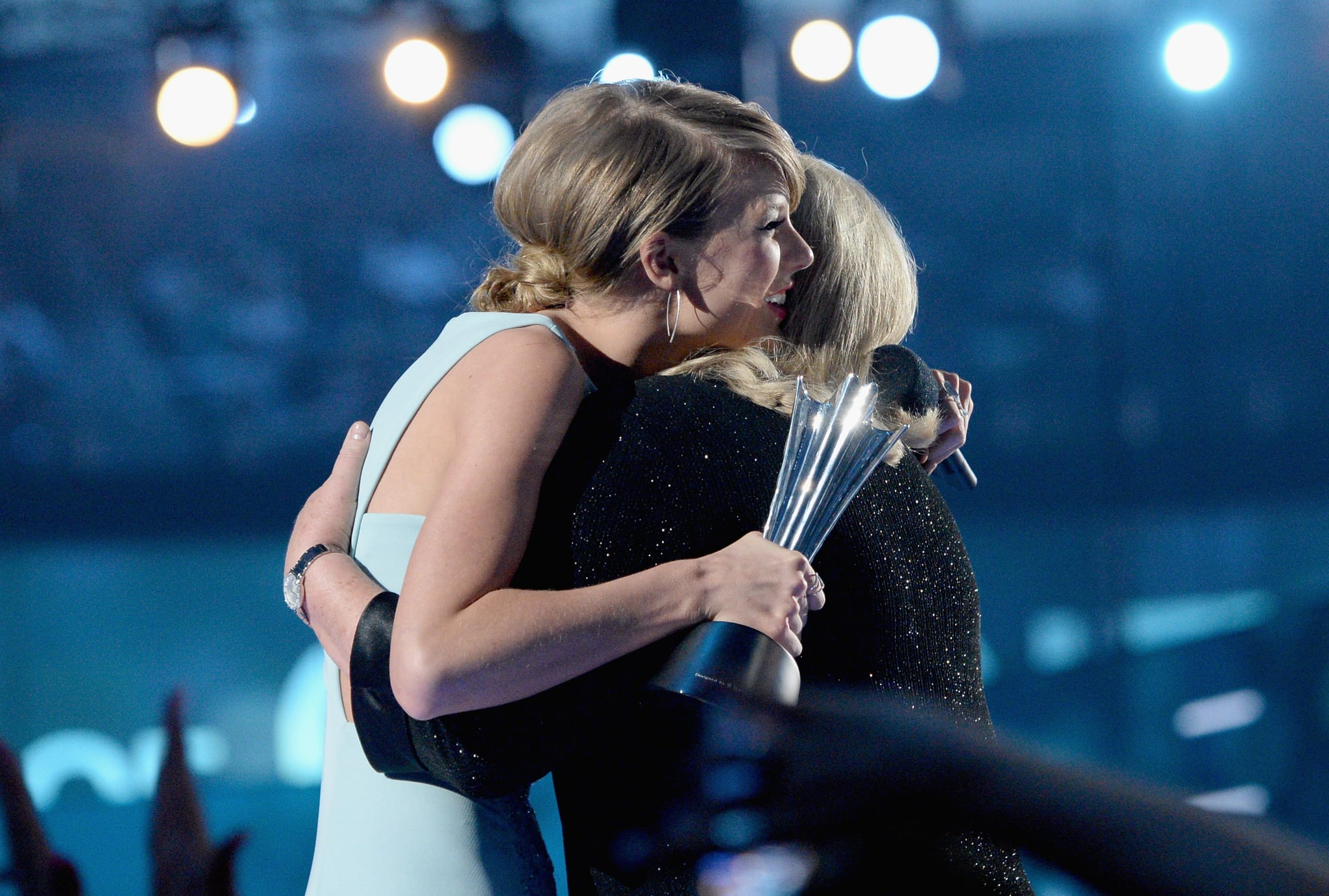ARLINGTON, TX - APRIL 19:  Honoree Taylor Swift (L) accepts the Milestone Award from Andrea Finlay onstage during the 50th Academy of Country Music Awards at AT&T Stadium on April 19, 2015 in Arlington, Texas.  (Photo by Mike Windle/ACM2015/Getty Images for dcp)