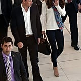 Kate Middleton traveled through Brisbane, Australia in a scarf and sweater with Prince William.