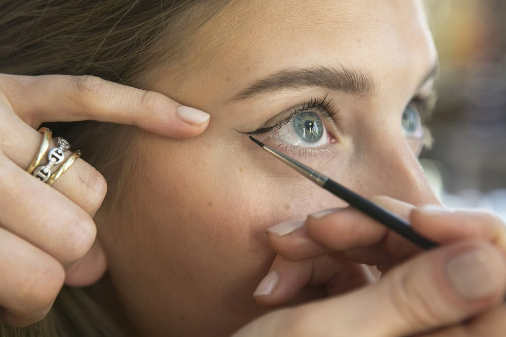 "After you've prepped your lids with primer, the ""first step is to apply the wing by drawing a line from the outer crease of the eye,"" Bettelli says. Use the lower lash line as a guide, and draw on the liner as though you're extending the lower lash line upward."