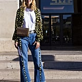 Wear a wrap-style polka-dot top open over a t-shirt with jeans and heels.