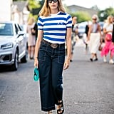 Top a pair of wide-leg pants with a fitted tee to balance out your proportions