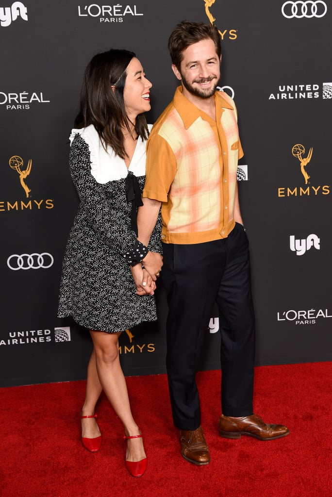 """A This Is Us and Pen15 crossover doesn't sound like it would work, but Michael Angarano and Maya Erskine's relationship is proof that it does. It's unclear when exactly the 32-year-old actor and 33-year-old actress started dating — they went Instagram official in September 2019 — but they sure are adorable together. In addition to sharing little glimpses of their love on social media, they've also walked the red carpet together from time to time.  They even attended a few award shows together back in 2019 when they were both nominated for their respective shows. """"Ohhh look who it is sitting right behind me completely randomly at an awards show in which we were both nominated who i also happen to be in love with,"""" Michael captioned a selfie of him and Maya at the Creative Arts Emmy Awards. Is your heart melting yet? Ahead of the season two premiere of Pen15, check out their cutest pictures together.       Related:                                                                                                           I Can't Be the Only One Obsessed With Maya Erskine and Anna Konkle's Friendship"""
