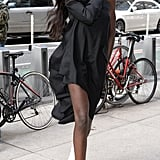 Duckie Thot styling her black minidress with white boots.