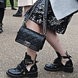 A tough-girl boot is a perfect counterpoint to a classic Chanel bag and sequins.