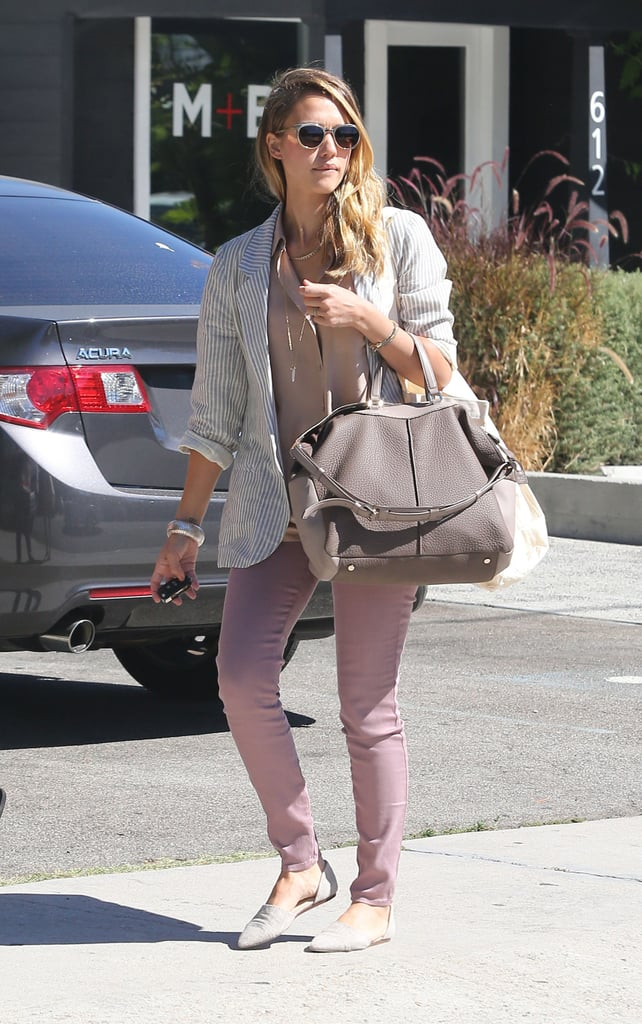 A newly blond Jessica Alba swung by Jenni Kayne's store in West Hollywood yesterday. Jessica, who recently lightened her hair to reprise her role as a stripper in the upcoming sequel to Sin City, was already wearing a pair of D'Orsay flats from Jenni's line when she showed up to shop. Changing her locks isn't the only thing she's done to prepare for her next part. Earlier this week, Jessica visited a shooting range to practice her marksmanship. She's spent much of her Summer at home in LA focusing on her next film, her family, and her business venture, The Honest Company. In July, however, she took a time out to visit NYC and to take her daughters and mother on an Italian getaway.