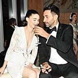 Rooney Mara sipped on champagne with help from designer Riccardo Tisci at the afterparty.  Source: Neil Rasmus/BFAnyc.com