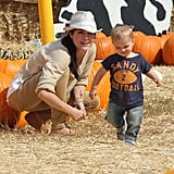 Selma Blair had a smile on her face watching son Arthur scurry through the hay at a patch in LA.