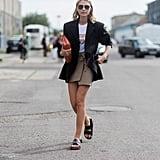 """Ugly"" sandals make a blazer-and-miniskirt combo feel fresh."