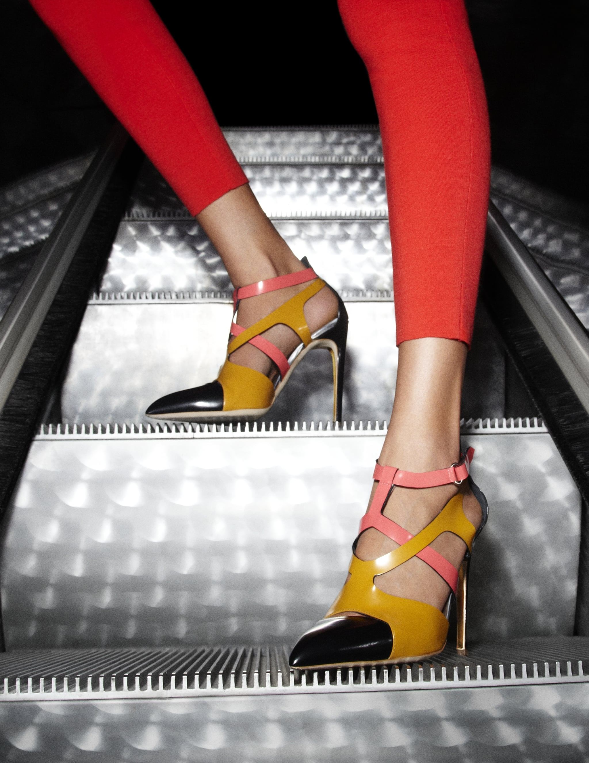 Between the strappy Moiki pumps, red pants, and glistening escalator, this is one hot shot. Photos courtesy of Rupert Sanderson