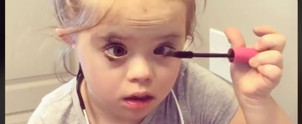 Girl With Down Syndrome Putting on Her Own Makeup