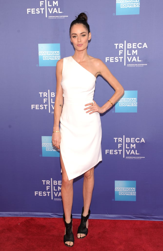 At The Battle of amfAR premiere at the Tribeca Film Festival, Nicole Trunfio played with black and white in a one-shouldered dress and cutout booties.