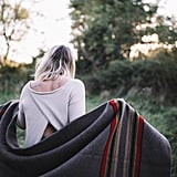 Being wrapped up in a soft blanket.