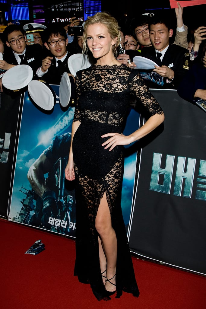 """Brooklyn Decker hit the red carpet this evening at the Seoul premiere of Battleship. Brooklyn, decked out in a black lace dress from femme d'armes, was joined by her leading man Taylor Kitsch and director Peter Berg. Both Taylor and Brooklyn were recently in Japan, where they linked up with castmates Rihanna and Alexander Skarsgard for other press events. So far, Brooklyn Decker's red-carpet style has been catching attention on her current promotional tour. Many of the stops so far have been affiliated with military bases, owing to the plot of the action film. Brooklyn thanked service people for going out for the premiere. She wrote on Twitter that the """"Seoul premiere was unbelievable. To the Korean and US Navy who came out, we were overwhelmed by the support! Truly, thank you."""""""