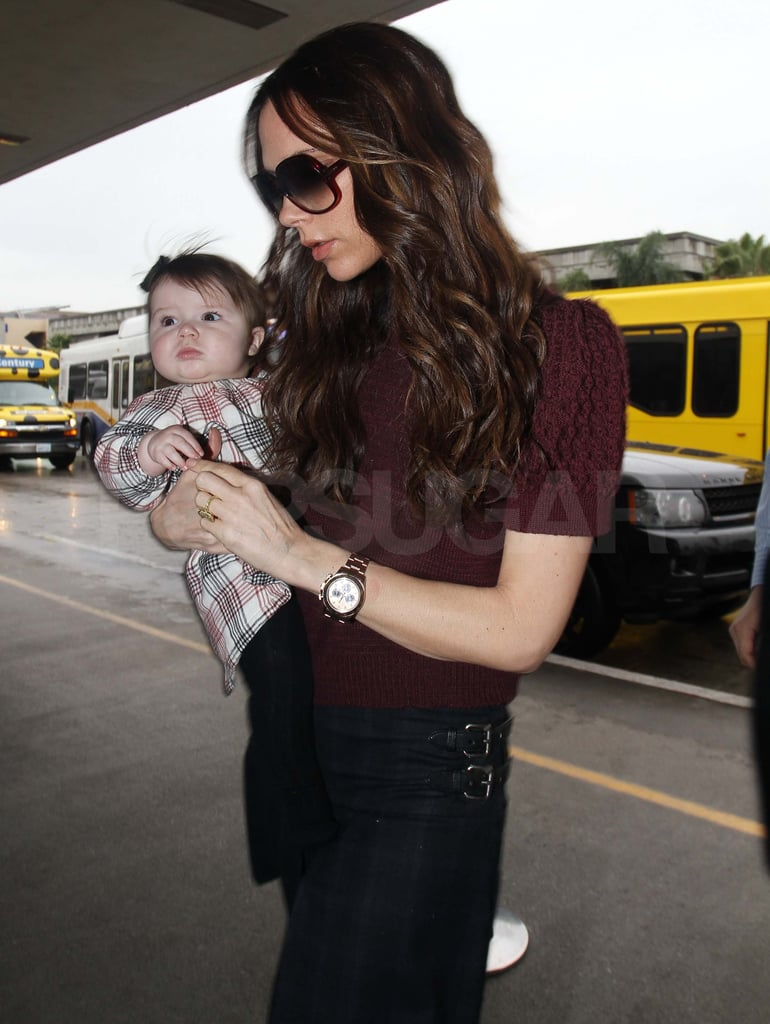 Victoria Beckham with Harper wearing a plaid dress.