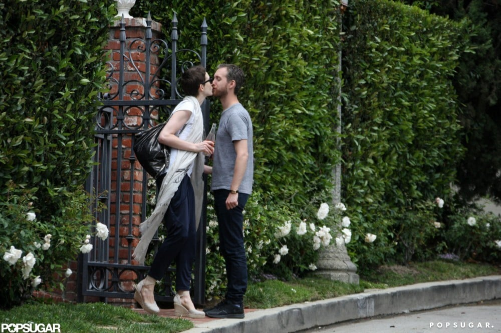 Anne Hathaway and Adam Shulman kissed outside a friend's house in LA in May.