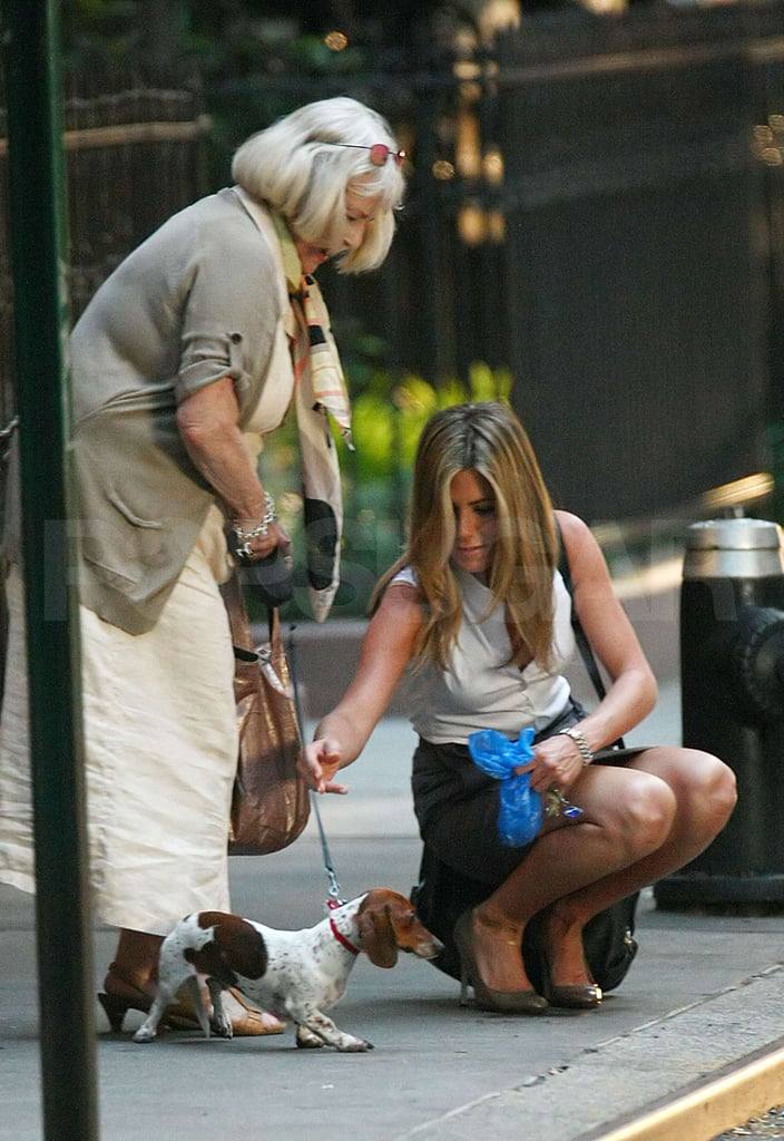 Jennifer Aniston picking up poop