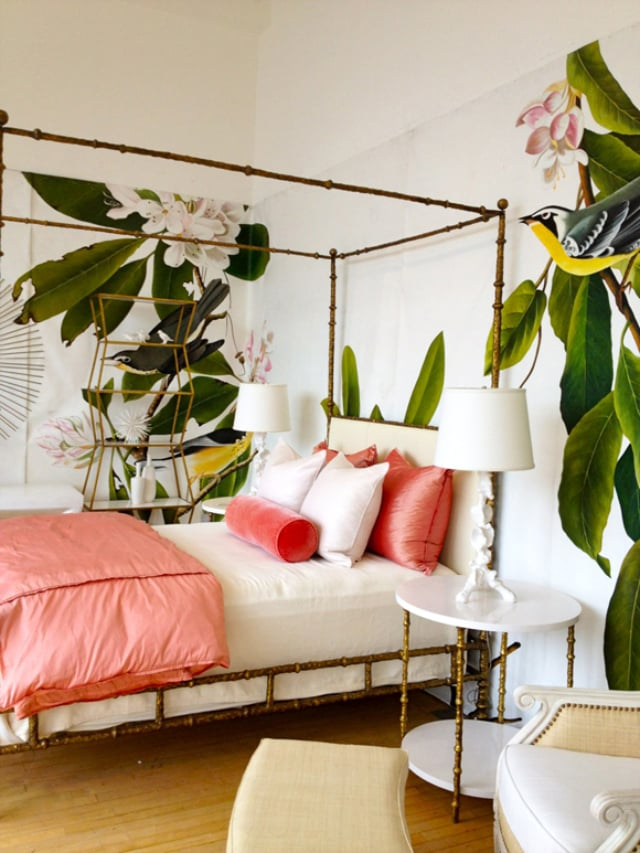 Bamboo furniture and large flora make this bedroom feel just like Tarzan's jungle.