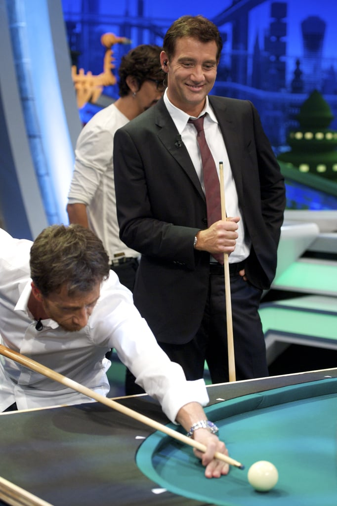 Happy Friday! Here are some hot pictures of an animated Clive Owen appearing on the Spanish TV show El Hormiguero yesterday afternoon. He looked handsome, as usual, while chatting with the program's host and even gamely playing a round of pool. Clive is making the media rounds to chat up his two newest movies. His Intruders opens in Spain today while Killer Elite hits theaters in various European countries later this month. Clive has just wrapped up a busy Summer of jet-setting. He completed work on James Marsh's Shadow Dancers, which costars Andrea Riseborough and Gillian Anderson and is now prepping to report to the set of Cities. In the latter, Clive will play a hedge fund manager living the high life in the run up to the all-time Dow Jones stock market high. Aside from all the filmmaking, Clive's also indulged his philanthropic side. Clive is one of the many stars appearing in The F Word PSA for One along with George Clooney, Jessica Alba, Bono, and more.