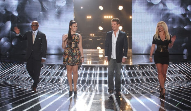 "The X Factor put their 12 remaining contestants through the wringer last night when they had to perform songs from music's greatest divas like Celine Dion, Mariah Carey, and Tina Turner. Judges Britney Spears, Simon Cowell, Demi Lovato, and L.A. Reid sat front and center while the hopefuls pulled out all the stops to save themselves from elimination. First up was Jennel Garcia, who set a high bar with her performance of ""Proud Mary."" Next, fan favorite Tate Stevens took on Shania Twain's ""From This Moment On."" Britney's team of young adults, made up of Diamond White, Beatrice Miller, Arin Ray, and Carly Rose Sonenclar, made her proud with four impressive ballads.  The night was full of highlights, though there was a tense moment when L.A. gave harsh criticism to Cece Frey's rendition of Celine Dion's ""All by Myself."" Demi, who mentors Cece, fired back at L.A. and challenged his opinion. We'll have to wait and see if Demi's support was enough to save Cece from elimination when the show returns tonight with a results episode that also includes a performance from Taylor Swift.  Source:"