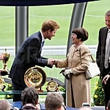 Prince Harry meets people at the King George Horse race.