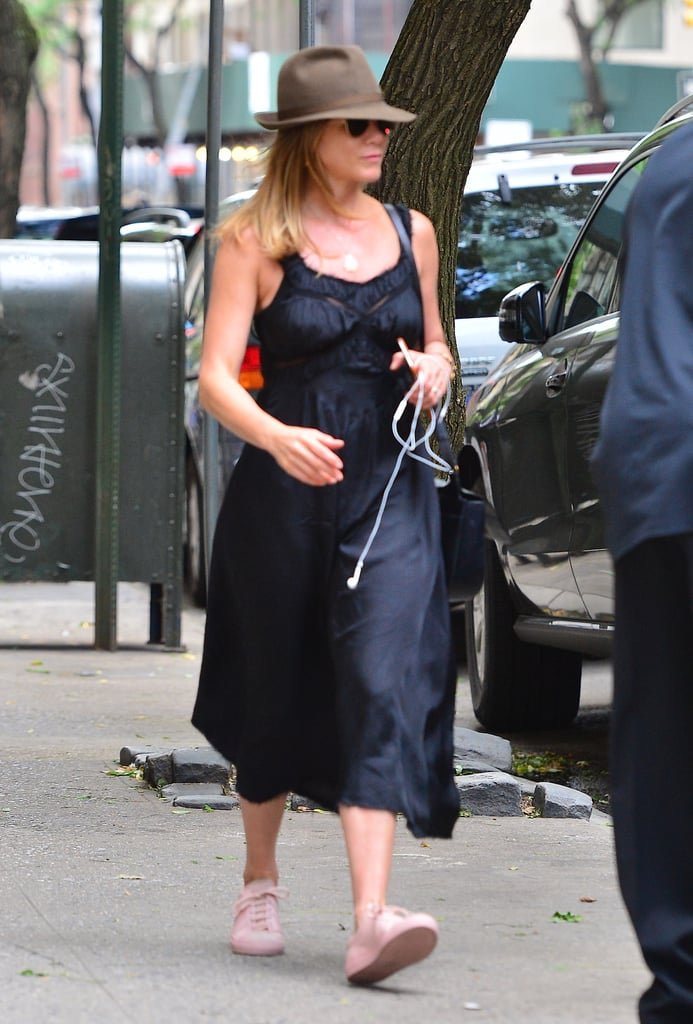 Wearing a black satin dress with sneakers in June 2016.
