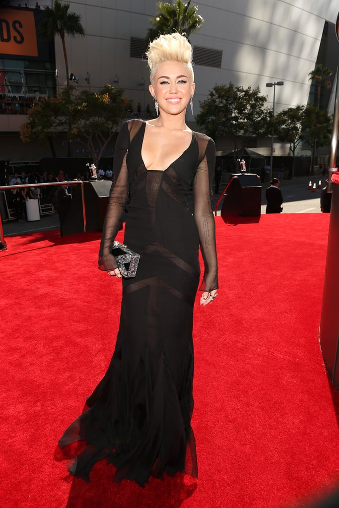 Miley Cyrus wore a sexy black dress to the 2012 show.