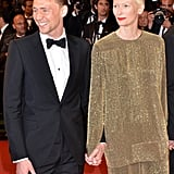 Tom escorted Tilda Swinton down the red carpet.
