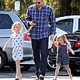 Ben Affleck was hand in hand with his daughters, Violet and Seraphina, in mid-August. Violet wore a white polka-dot dress, while Seraphina sported a pink polo beneath her shorts overalls.
