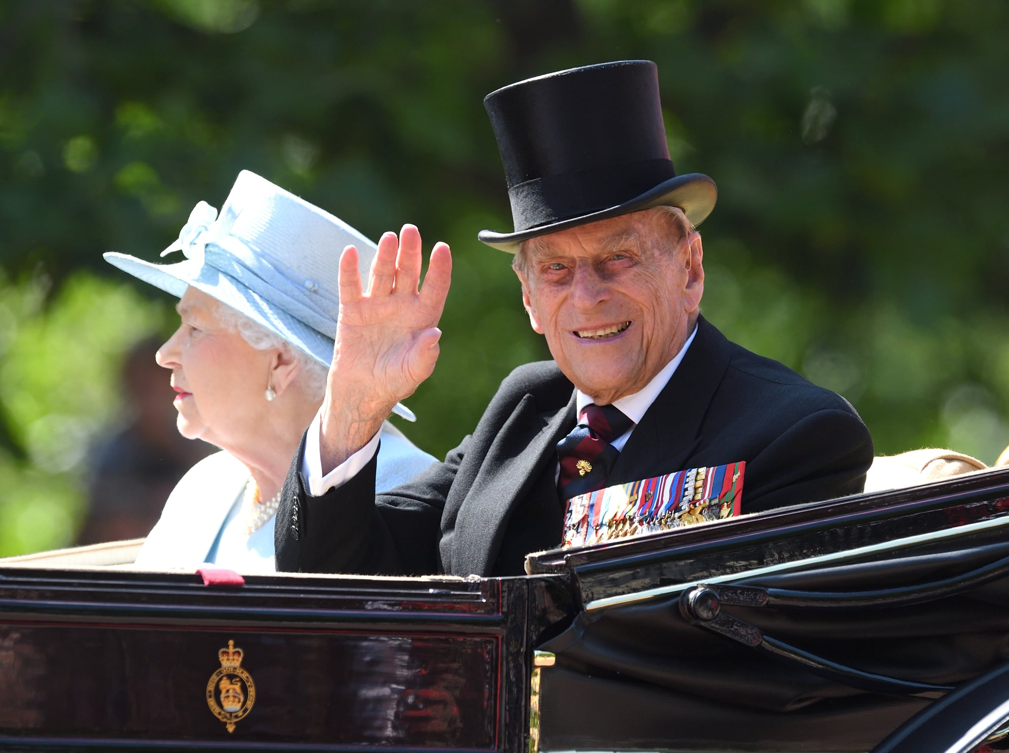 LONDON, ENGLAND - JUNE 17:  Queen Elizabeth II and Prince Philip, Duke of Edinburgh ride by carriage during the annual Trooping The Colour parade at the Mall on June 17, 2017 in London, England.  (Photo by Karwai Tang/WireImage)