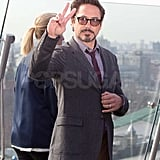 Robert Downey Jr. flashed a peace sign while promoting The Avengers in Moscow.