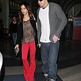 Jenna Dewan wearing red pants with Channing Tatum.