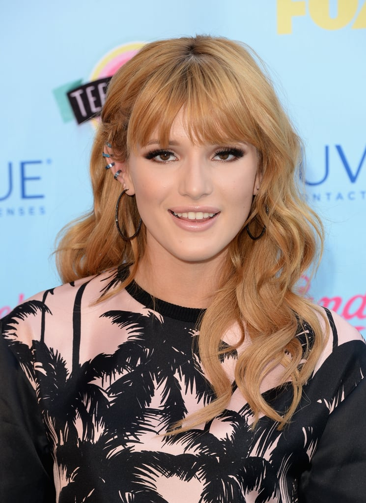 Bella Thorne went for high drama with her winged-out eyeliner, working a smoky black and bronze eye.