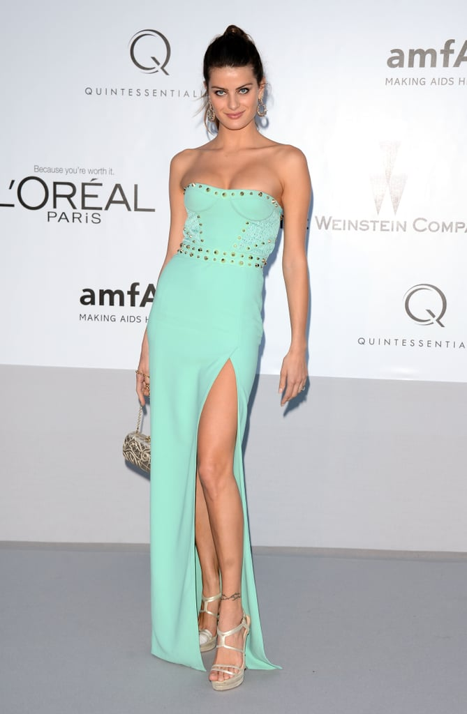 Isabeli Fontana donned a minty green gown, complete with thigh-high slit and rivet embellishments.