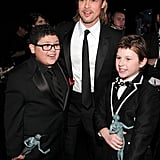 Rico Rodriguez, Brad Pitt, and Nolan Gould