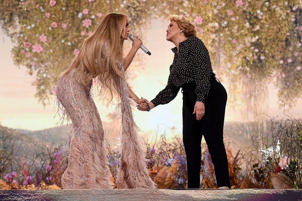 """Jennifer Lopez brought out a very special guest during the Global Citizen Vax Live's concert taping on 2 May. The """"Lonely"""" singer has previously credited her mom, Guadalupe Rodríguez, for her love of dance, so it only makes sense that the two shared the stage together in Inglewood, CA. Lopez introduced Rodríguez to the crowd, and together, the dynamic mother-daughter duo covered """"Sweet Caroline"""" by Neil Diamond.  This surprise duet feels like perfect timing since the Vax Live concert will premiere the day before Mother's Day in the US. """"Sing it to me just like you used to, OK?"""" Lopez told her 75-year-old mom in a Twitter video captured by Adelle Platon. Rodríguez switched the lyrics around for her """"Sweet Jennifer,"""" which is just such a typically adorable mom move, isn't it? Get a glimpse of the moment in the video and photos ahead.  Related: Should We Talk About J Lo's Crazy, Sexy Global Citizen Costumes All Day or All Month?"""