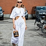 Pair your maxi white dress with sandals and a statement bag.