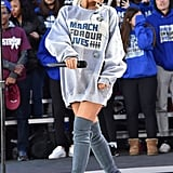 Ariana performed on site at March For Our Lives in Washington, DC at the end of March. We love how she coordinated the stamped oversize hoodie with her signature shoe of choice: Stuart Weitzman thigh-highs. Ariana accessorised with Harry Kotlar jewels.