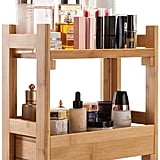 The Gobam Organiser Cosmetic Storage Holder ($US46) has a natural-wood finish and can hold products on the top and bottom shelf.