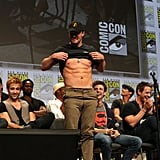 Stephen Amell put his abs on display at the Warner Bros. panel on Saturday.